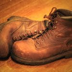 leather work boots on the floor with ankle support and steel toe