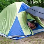 tent in the rain and umbrella