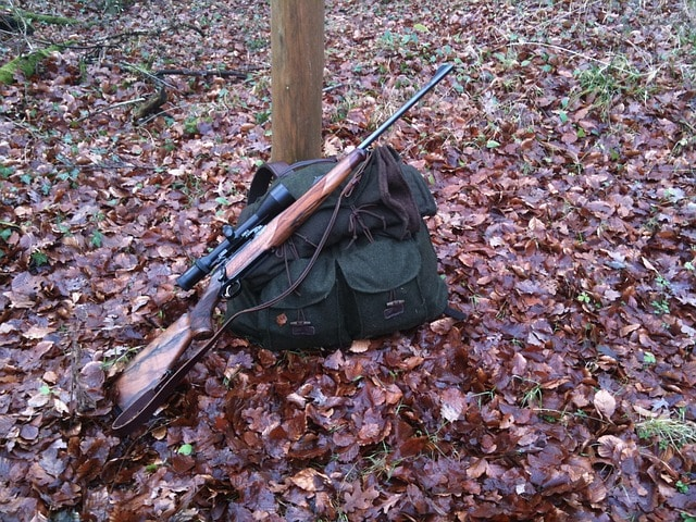 A rifle on a hunting backpack, an essential tool for packing and organizing your hunting gear