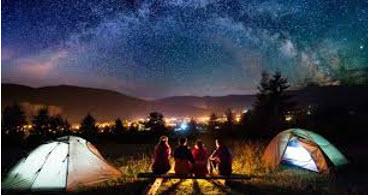 camping fire and starry sky