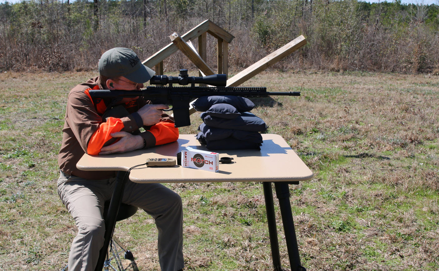 how to choose a shooting table - guy shooting ar15 from table